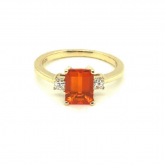 18 carat Yellow Gold Ring with Emerald Cut Fire Opal claw set with two Princess Cut Diamonds
